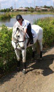 rider hugging a horse