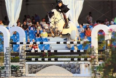 horse going over a jump